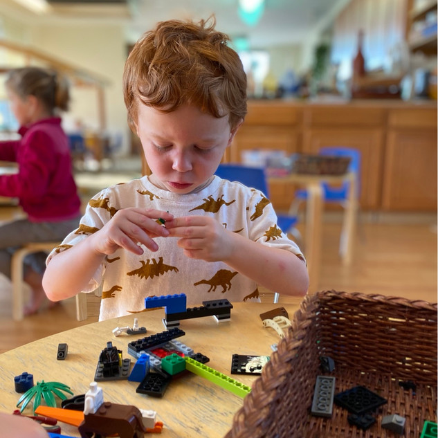 Dolan discovering legos. We like to pull out legos for concentrated fine motor work
