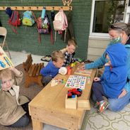 A variety of puzzle work in the outdoor classroom with Lori