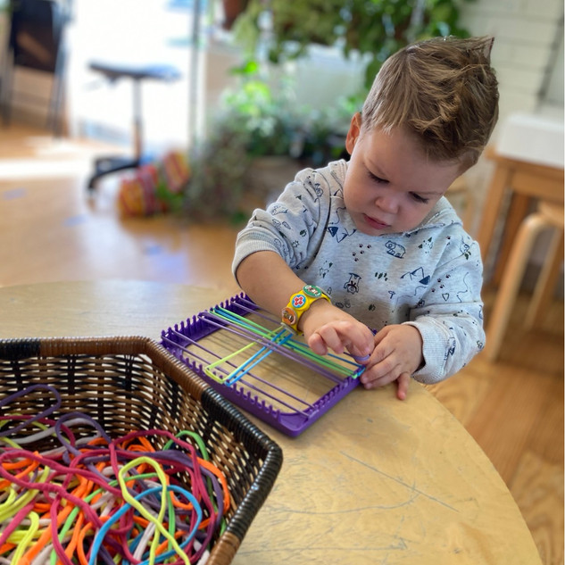 Marius's first day at Meadowlark! We recently introduced these potholder looms as geoboards!