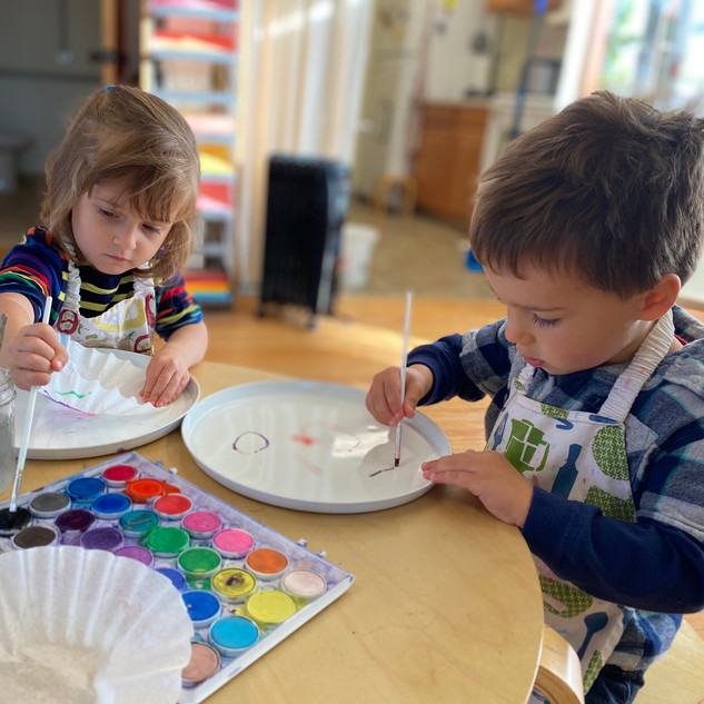 Eleanor and Charlie painting coffee filters