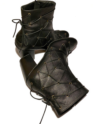 Leather boots with eyelet and lace details and a 3.5 inch block heel