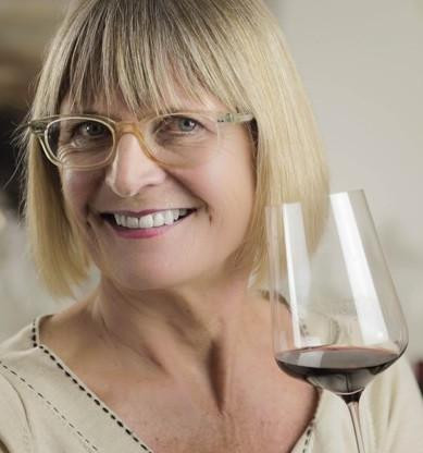 Jancis Robinson, Master of Wine, with a glass of red wine.