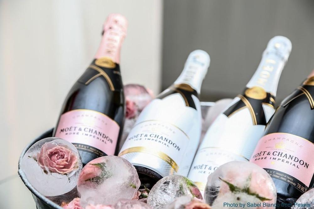Champagne bottles in ice bucket.