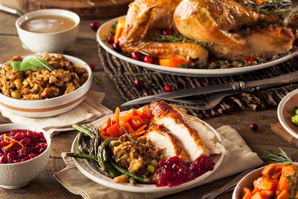 Thanksgiving dinner table full of food.