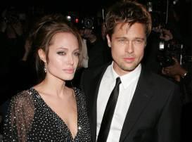 Picture of Angelina Jolie and Brad Pitt. Celebrities making wine.