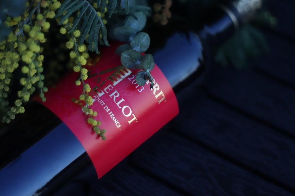 Bottle of Merlot on its side.