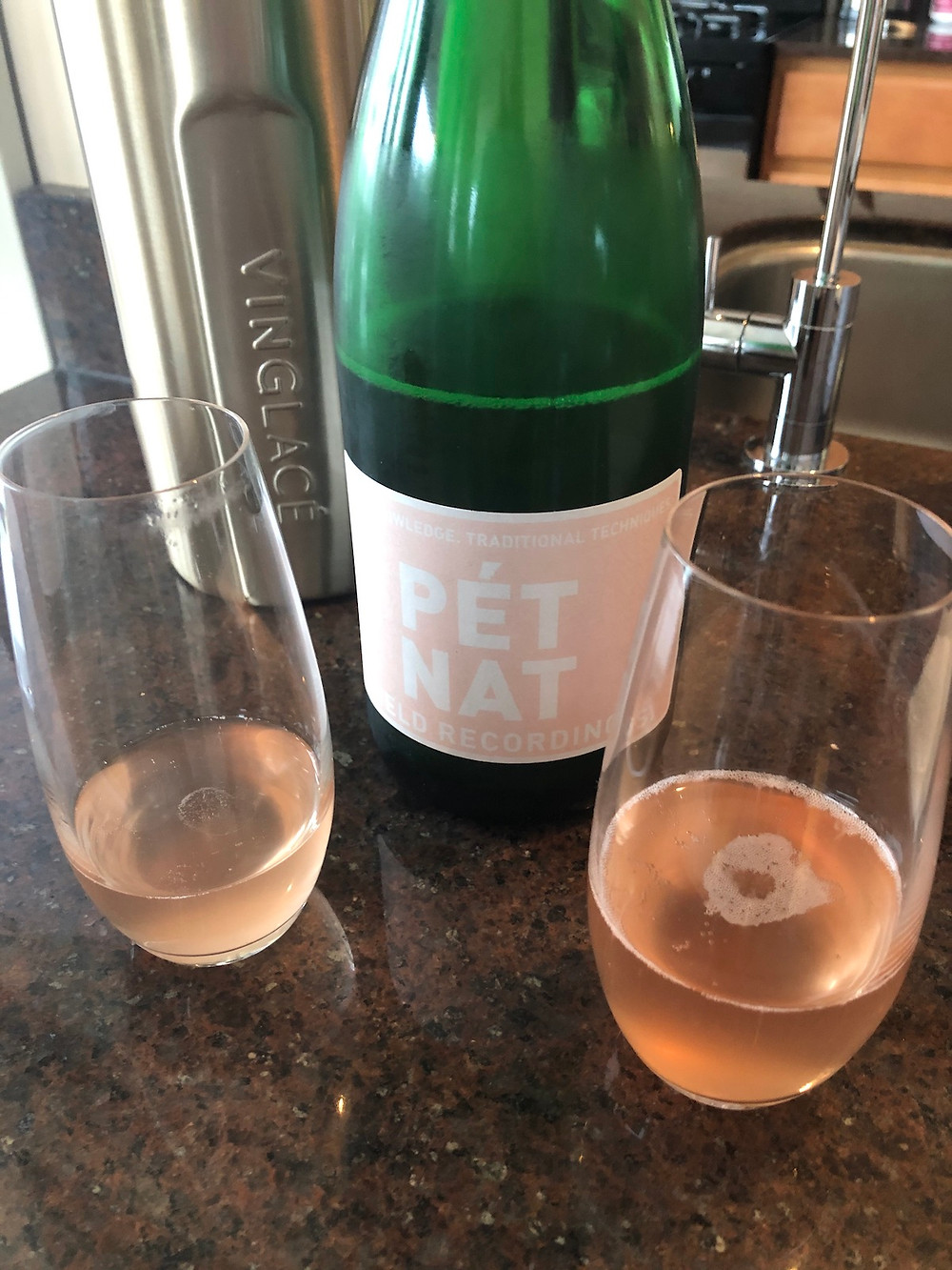 Bottle of Pet Nat Rose with 2 wine glasses.