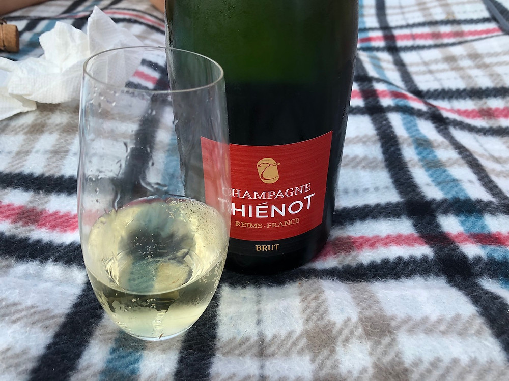 A bottle and glass of Thienot Champagne from France