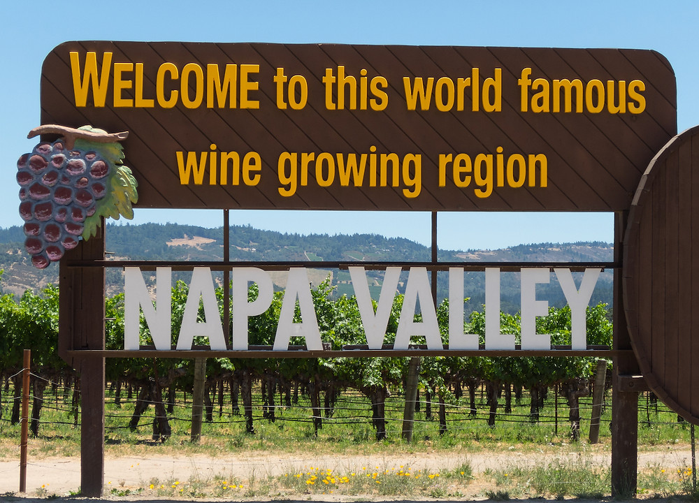 Napa Valley welcome sign says: Welcome to this world famous wine growing region - NAPA VALLEY