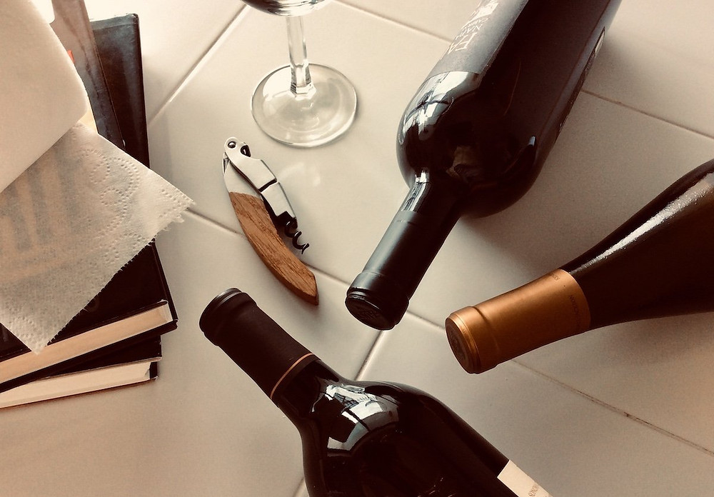 Wine bottles, books, and toilet paper.