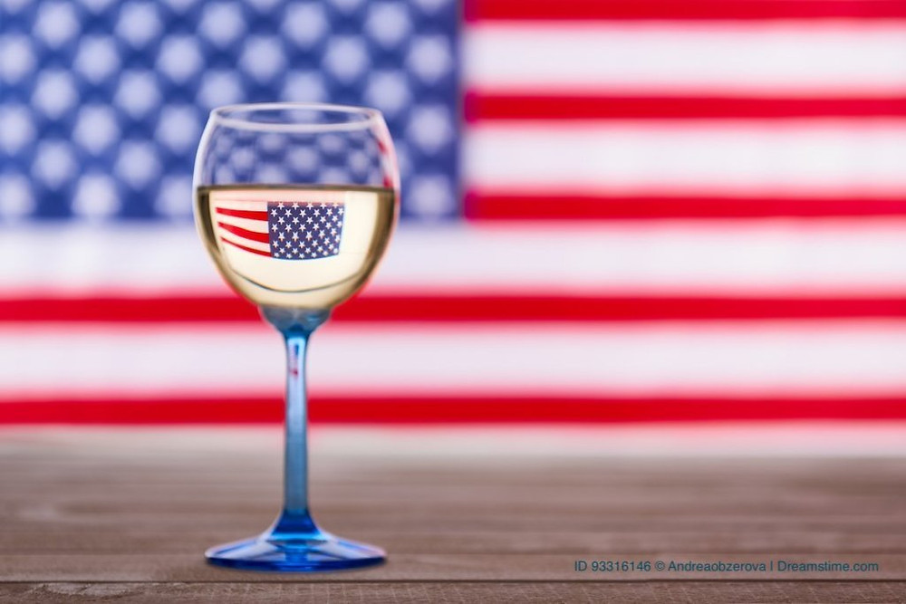 American flag and glass of white wine
