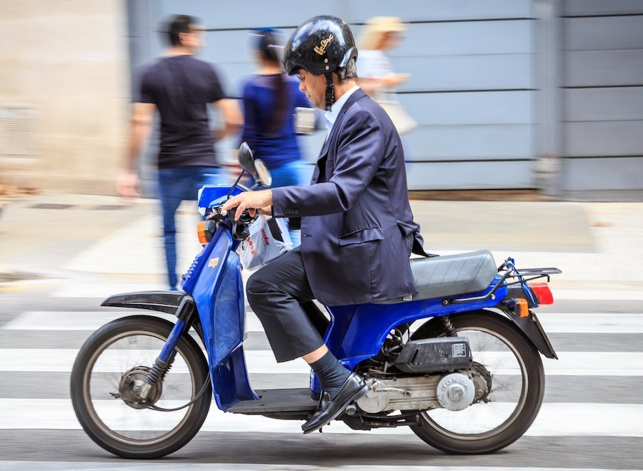 Man on a moving moped.