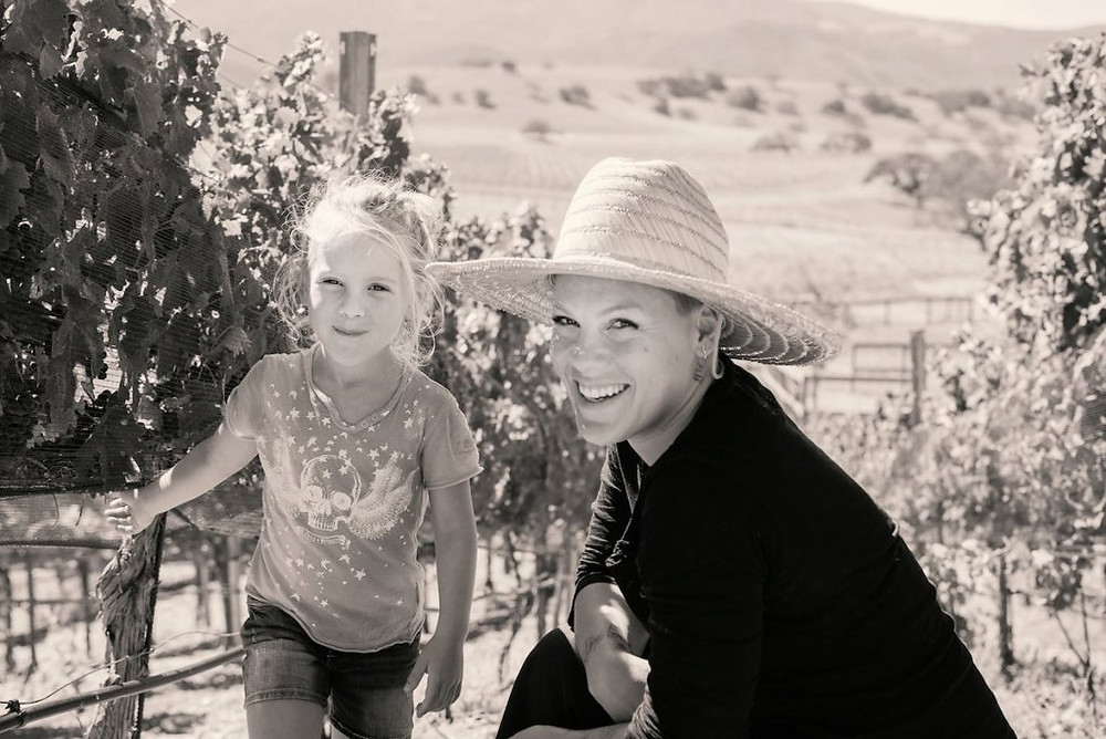 Pink with her daughter in their vineyard.