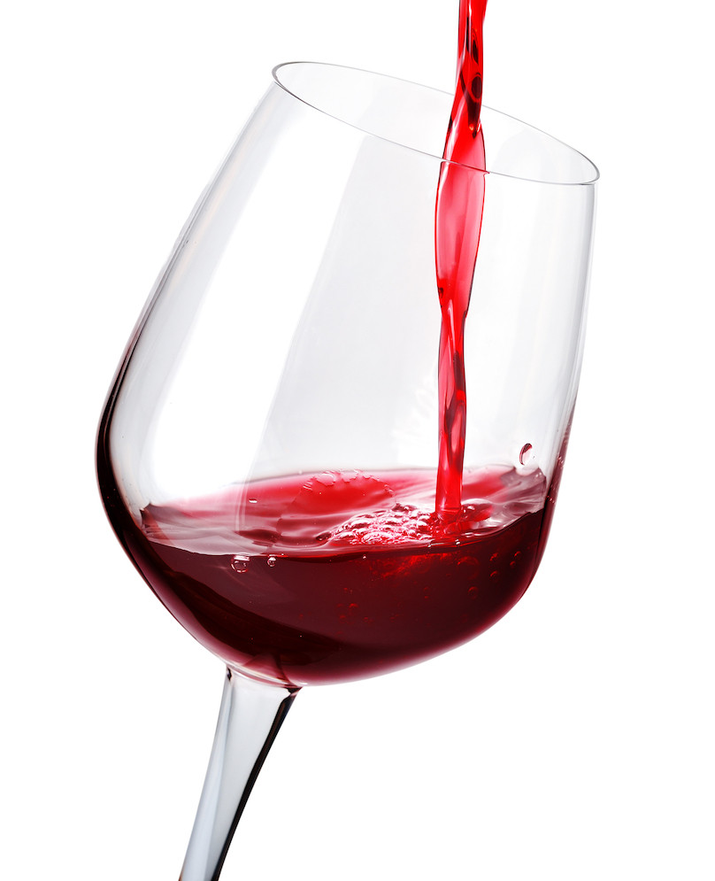 Red wine being poured into red wine glass.