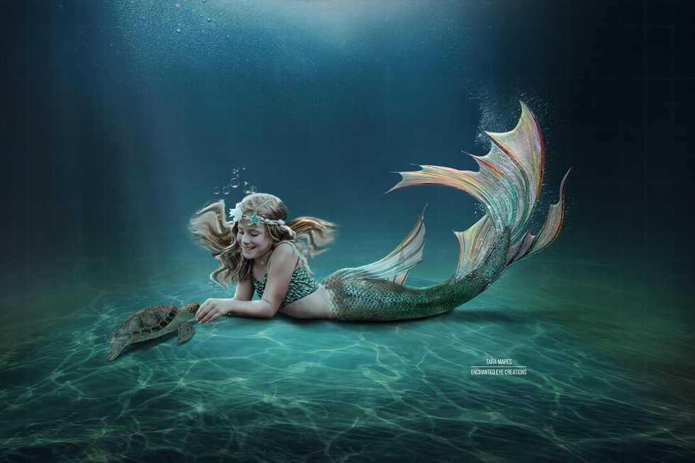 Mermaid on ocean floor