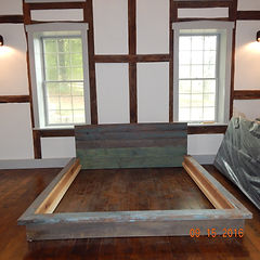 Custom bed made in our shop using original milk painted floor joists reclaimed from a log cabin