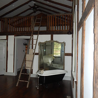 master suite with clawfoot tub below loft reading room