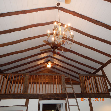 Loft in master suite built using timber frame barn