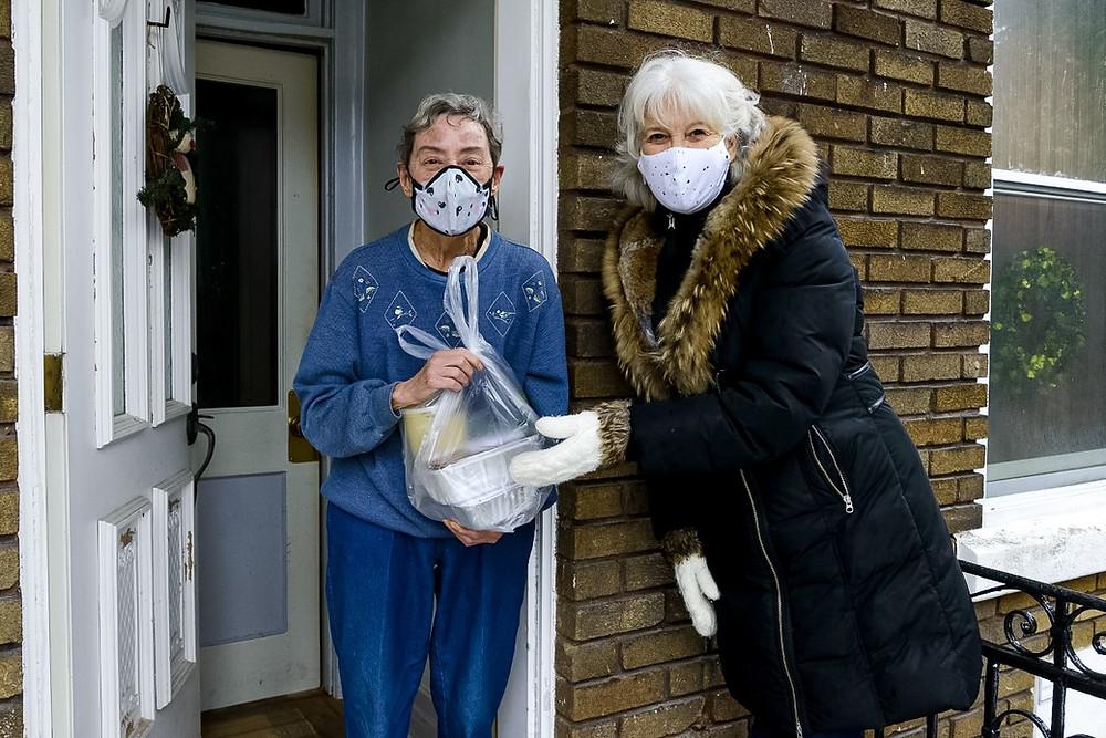 Volunteer delivering food to vulnerable population