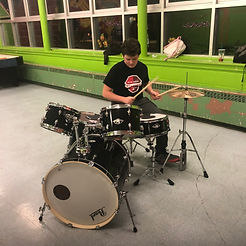 Youth playing drums