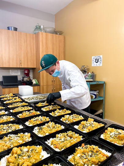 Man preparing meals for a food bank