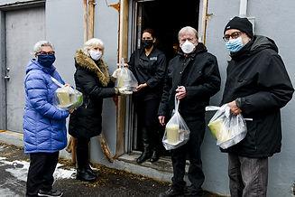 Volunteers delivering food