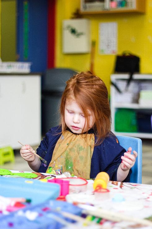 Toddler doing a craft