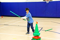 Kid playing in gymnasium