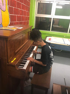 Youth playing piano