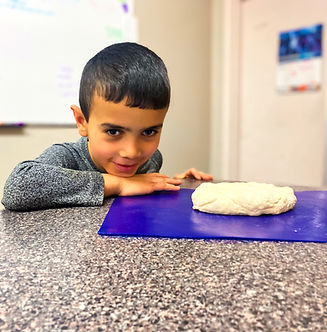 Child in a cooking class