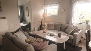 Sofa corner, with door open to double room