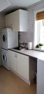 Vaskerom med vaskemaskin og tørketrommel