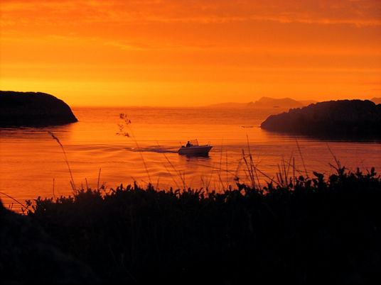 Båt i solnedgang, Nodre Gjelsa, Bulandet