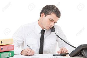 27043523-hardworking-young-man-talking-o