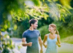 Man and woman running together sunshine coast mudjimba