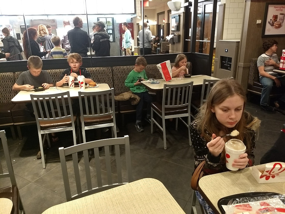 Kids eating Chick fil a