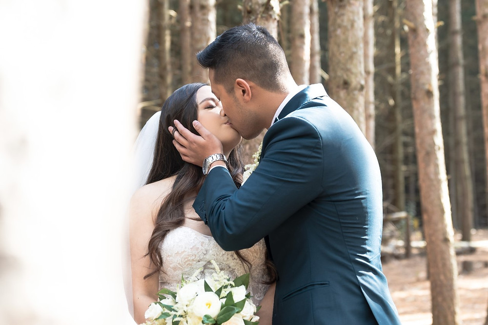 Bride and groom kissing at Kortright Centre