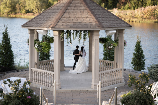 Bride and groom overlooking lake at The Ambassador