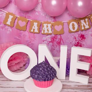 pink baloons smash purple cake