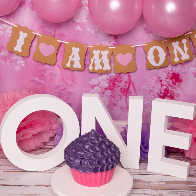 pink baloons smash purple cake