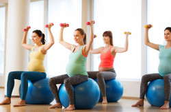 pregnancy, sport, fitness, people and healthy lifestyle concept - group of happy pregnant women with