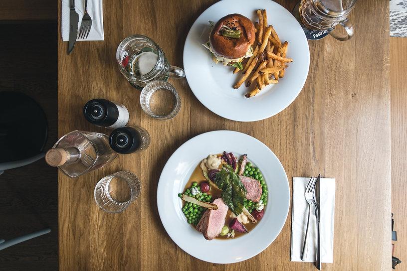 foodiesfeed.com_dinning-burger-and-grilled-pork-tenderloin-in-restaurant.jpg