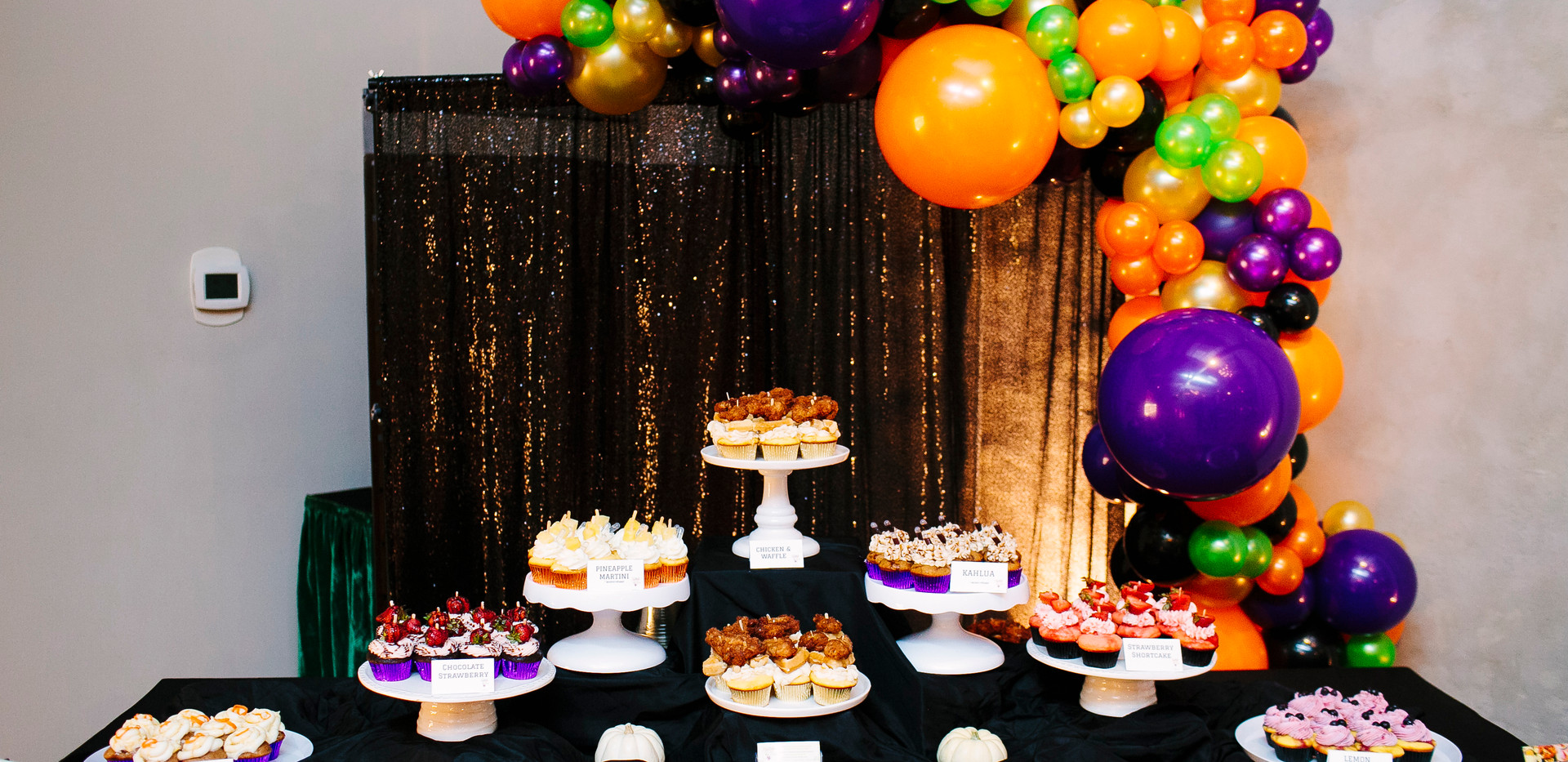 Dessert table for Randy's 50th Birthday Party. Cupcakes made by The Kupcake Bar. Balloon garand by Sitting Pretty Event Rental