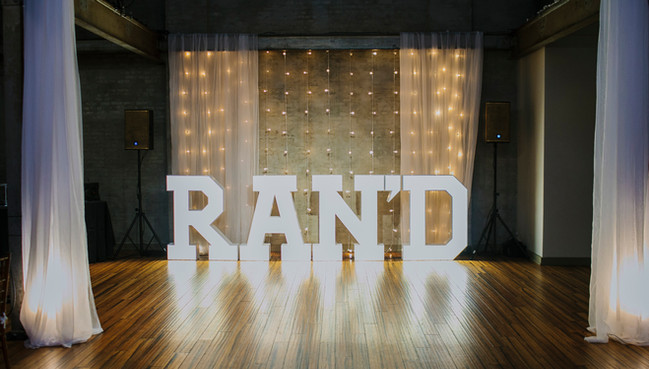 RanD letters on stage