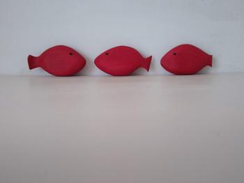 Three red fish