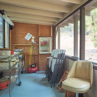 Screened outdoor studio area