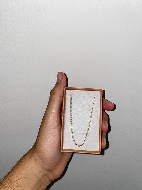 Cadena plana 3 oros 1.5 gramos 50 cms