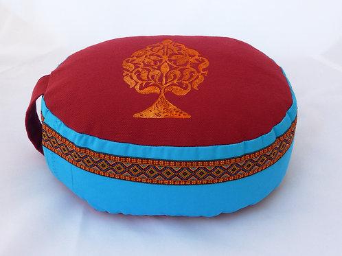 Coussin Ovale turquoise et rouge impression Arbre stylisé jaune orangé, galon