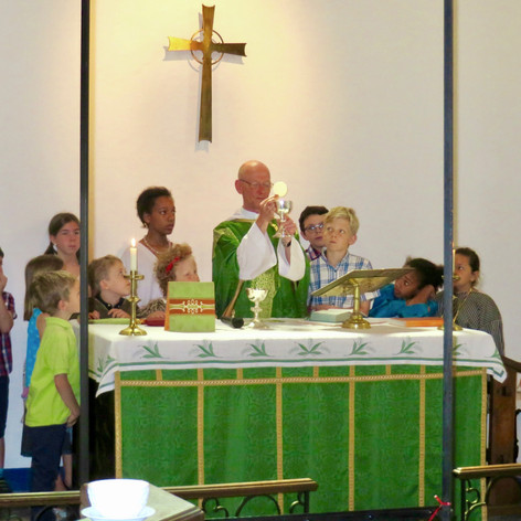 All eyes transfixed on the Blessed Sacrament at Mass