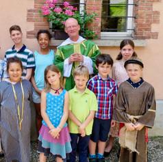 Fr Nigel with Sunday School children